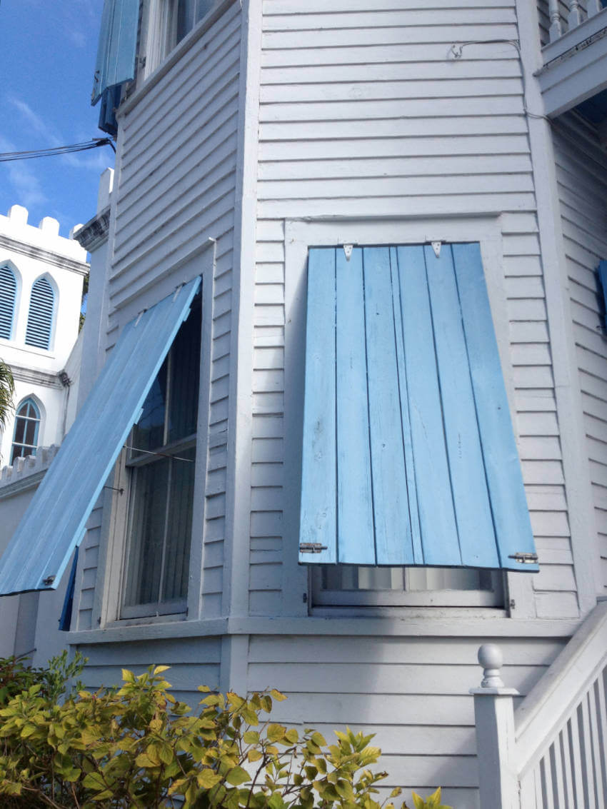 Add storm shutters or nail boards to secure windows.
