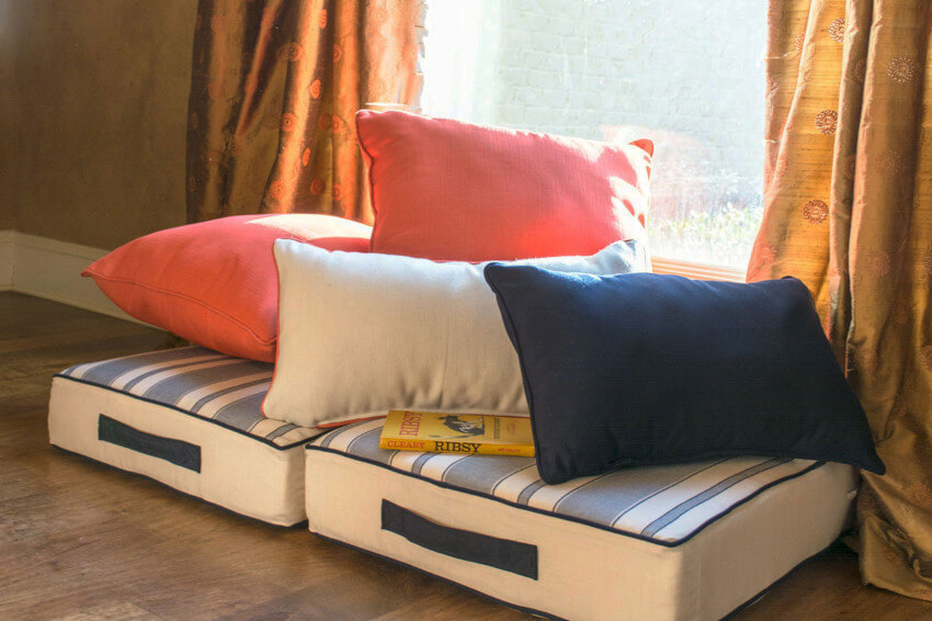 Cushions and pillows on the floor can be comfy.