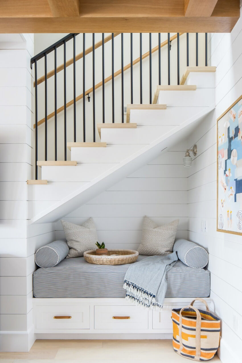 Maximize the use of space by adding a reading nook under stairs.