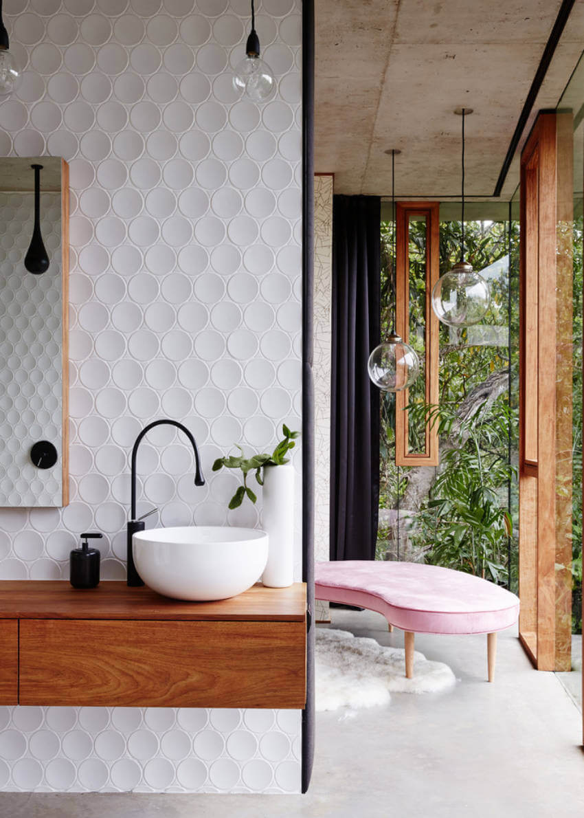 A textured white wall with a green plant might be what your bathroom needs.