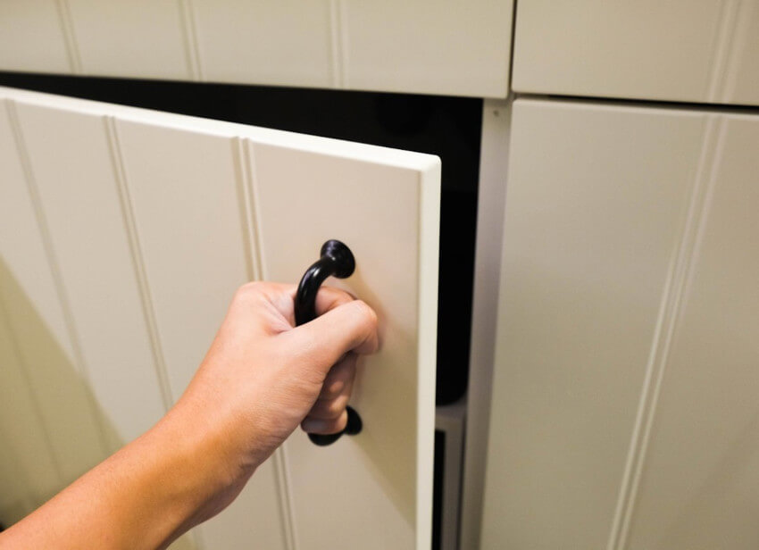 Opening cabinet doors can help to prevent frozen pipes.