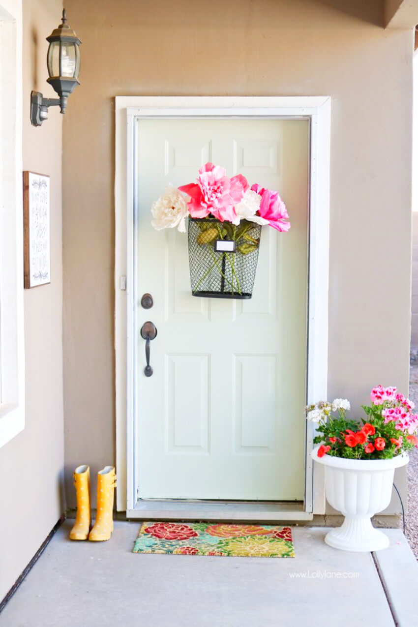 Use a basket and some fake flowers to make a statement in your home!