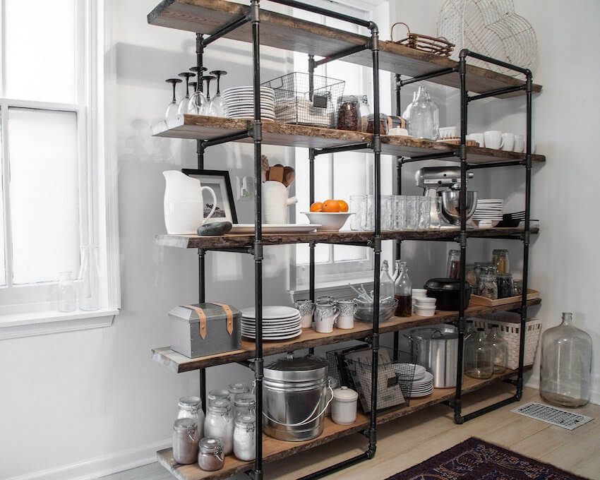 Small items like this repurposed pipe shelving unit add a hint of industrial style without any sort of in-depth home remodel.