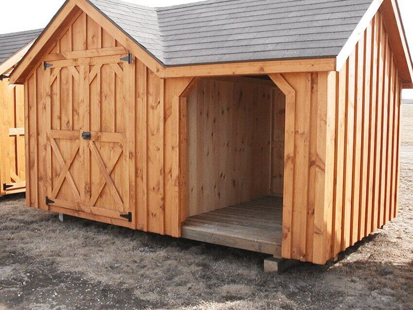 Home exterior siding: This shed matches the style of the house.