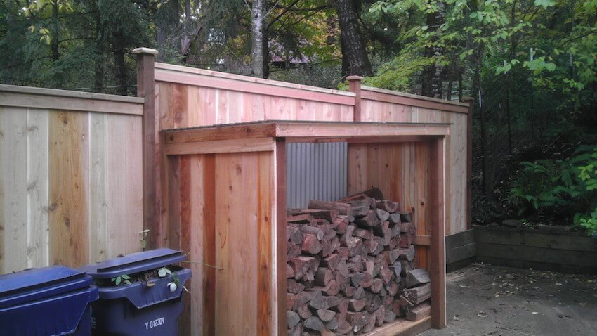Upcycling a wooden fence can make a DIY firewood shed a breeze to build.