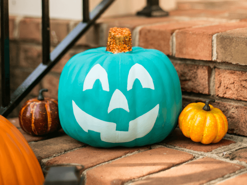 Let people know you're a part of the project with a friendly face on a teal pumpkin!