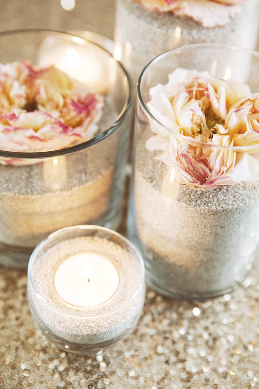 Flower and sand centerpieces for your beach wedding!