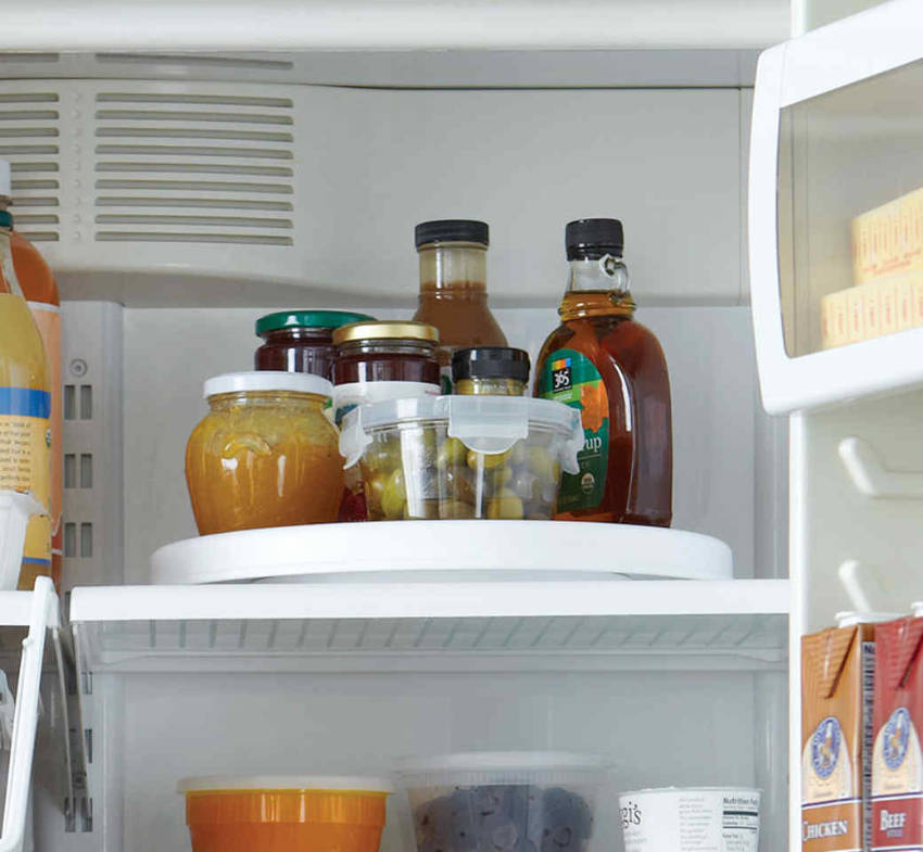 A lazy susan will make it easier to reach the depths of your fridge.