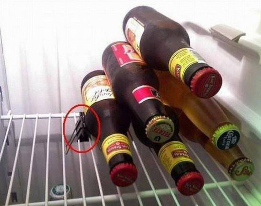 Binder clips are useful to stack bottles inside your fridge.
