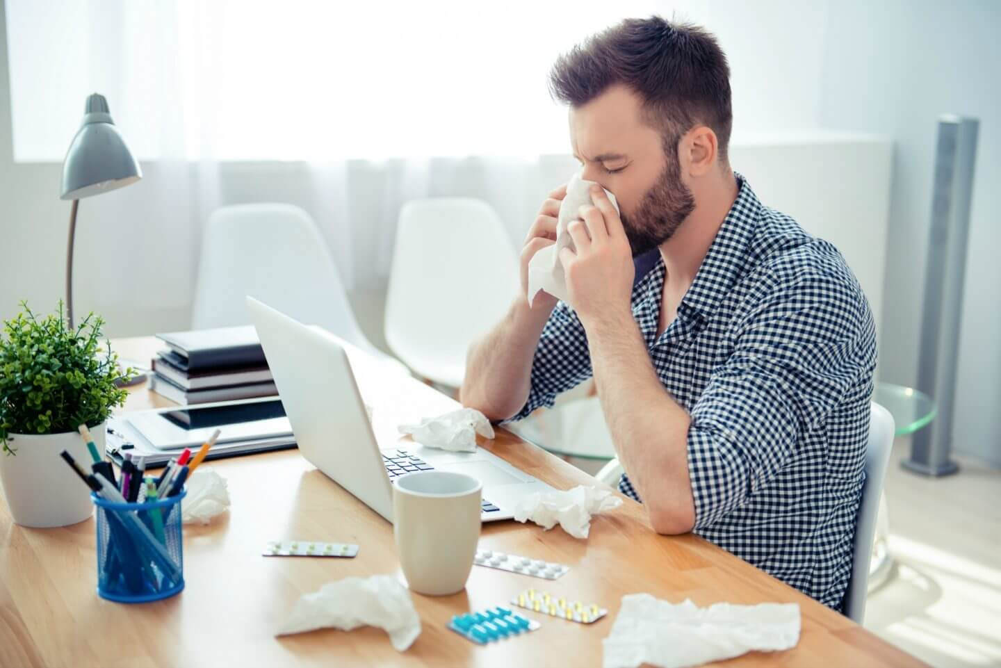 If you do have to sneeze at work, cover your mouth