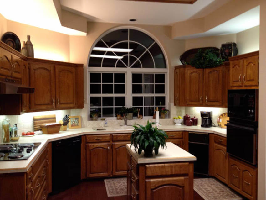Wooden cabinets gave this kitchen a dated look.