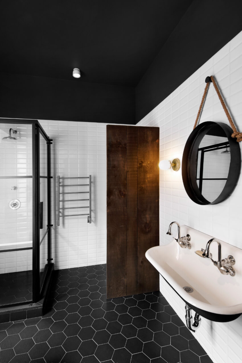 The black ceiling and flooring combo makes this bathroom unforgettable