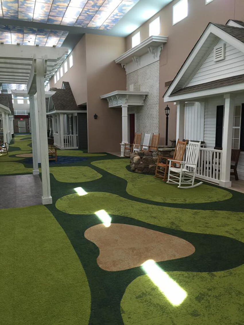 The floors are painted or covered in carpet to look like grass.