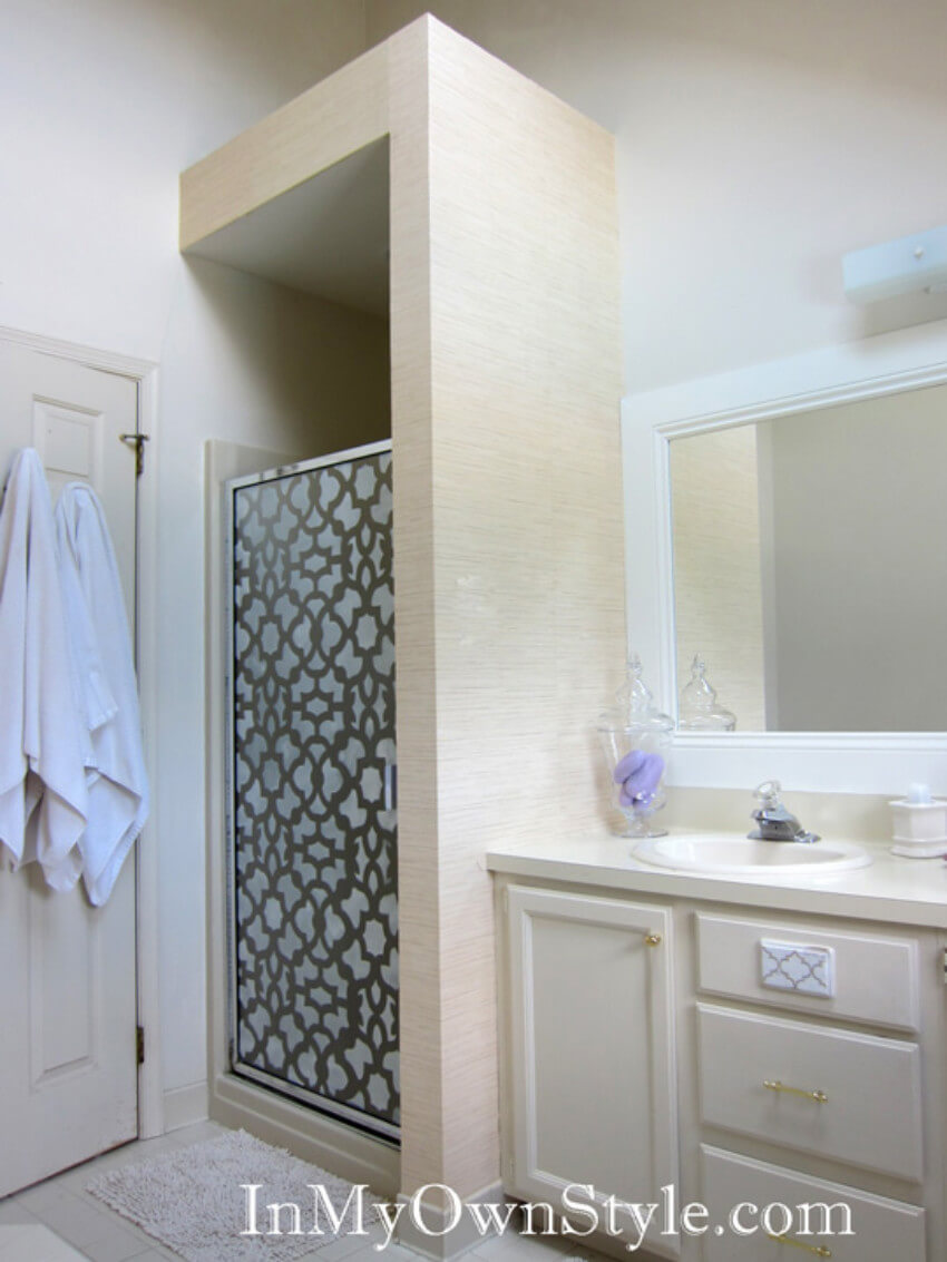 A DIY stenciled door is an affordable way of upgrading your shower doors.