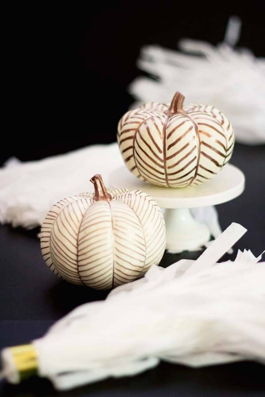 Spooky Halloween pumpkins decorated in golden herringbone patterns look beautiful.