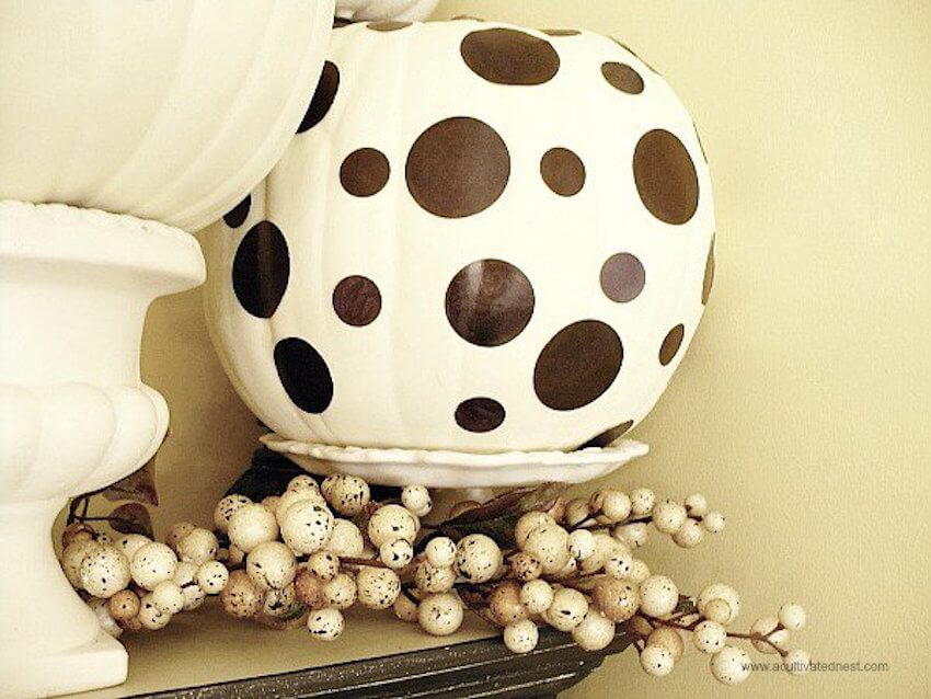 This White Home Decor Pumpkin looks great decorated with polka dots painted with a black sharpie.