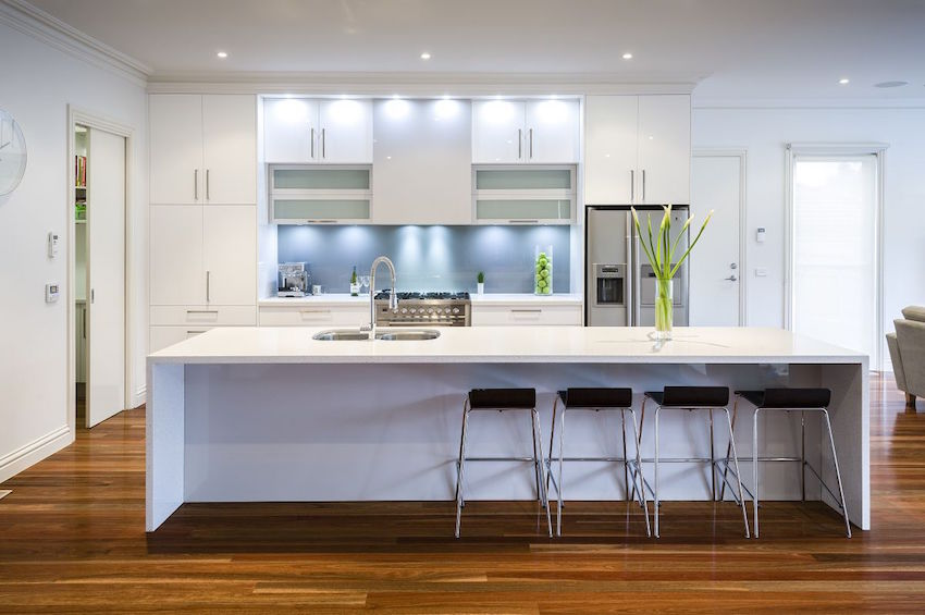 White kitchen cabinets can be modern too with the right hardware.