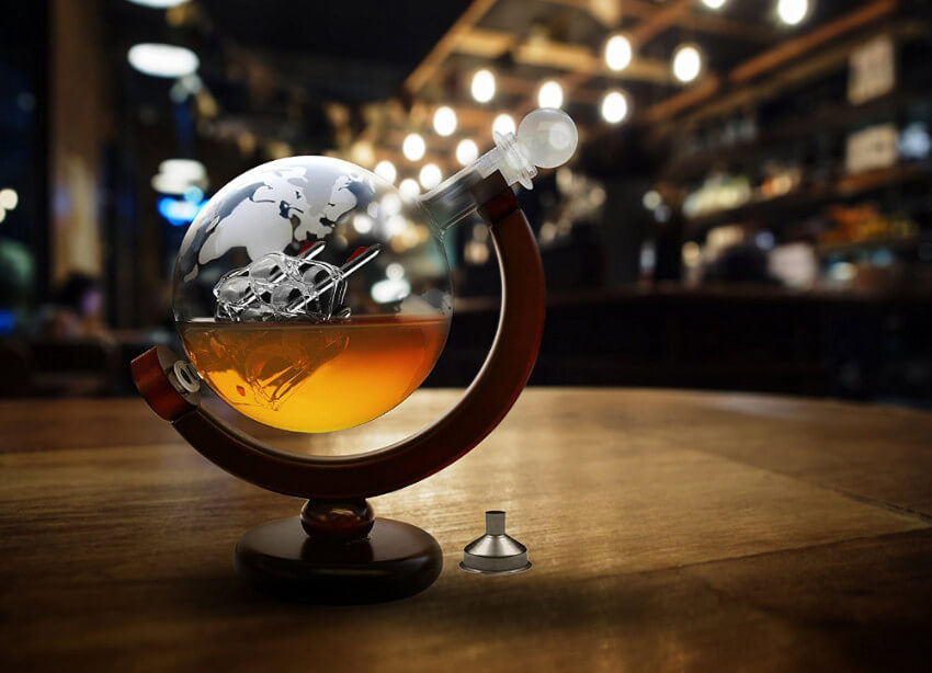 A globe whiskey decanter to spark his wanderlust (and hint that you should travel together