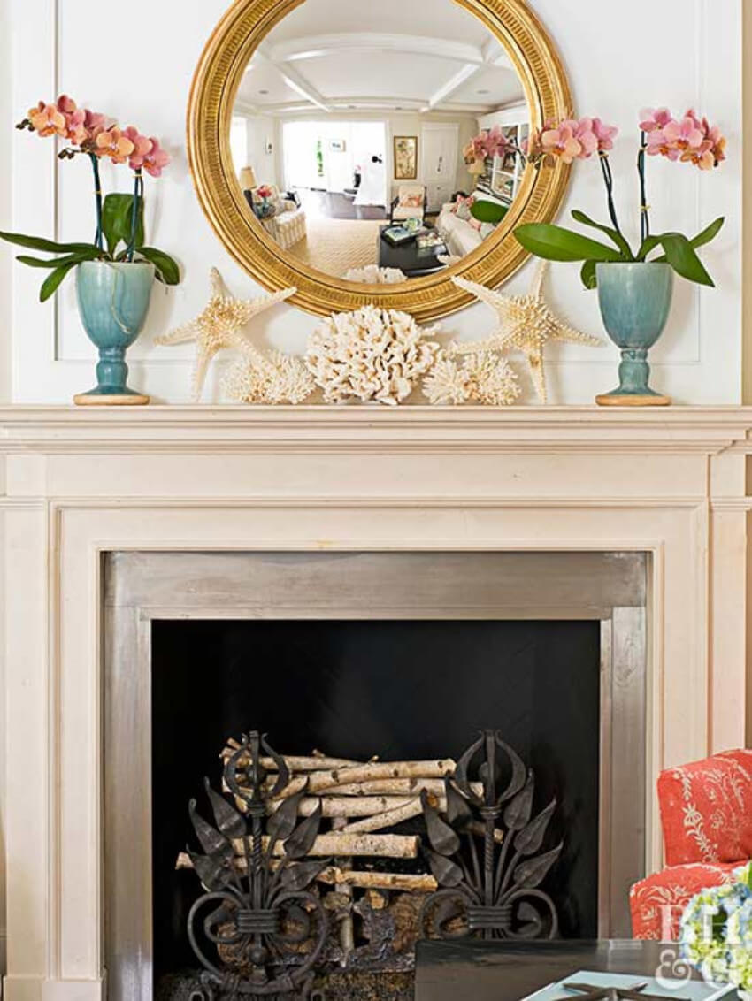 Bring a cozy and light mood to your fireplace by adding some flowers!