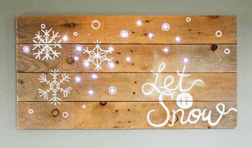 A pallet with a nice message is a great idea for winter decor!