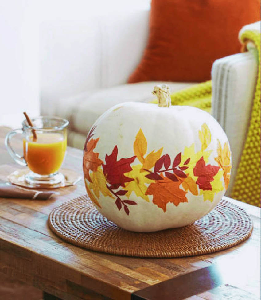 This white pumpkin decorated with fallen leaves is amazing!