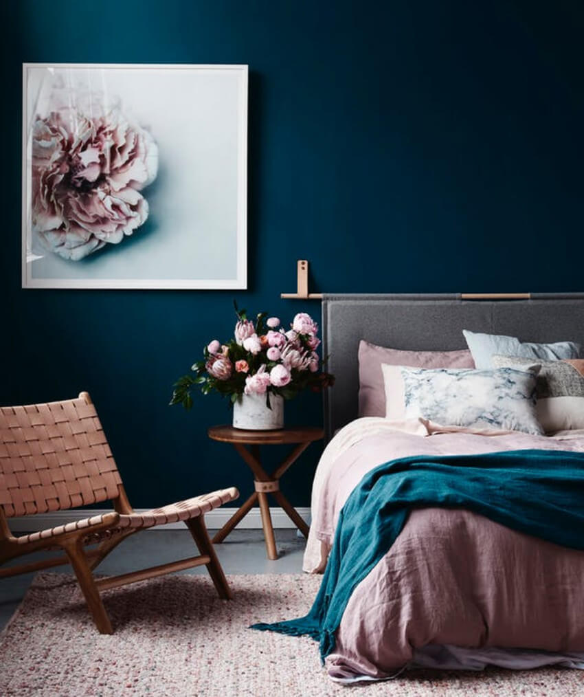 It's okay to have some style with a dark bedroom, as long as light can still come in!