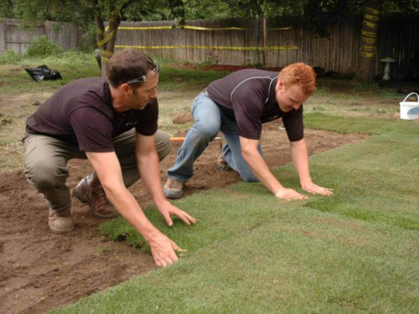 Re-grading the lawn can be the solution for water pooling in your yard.