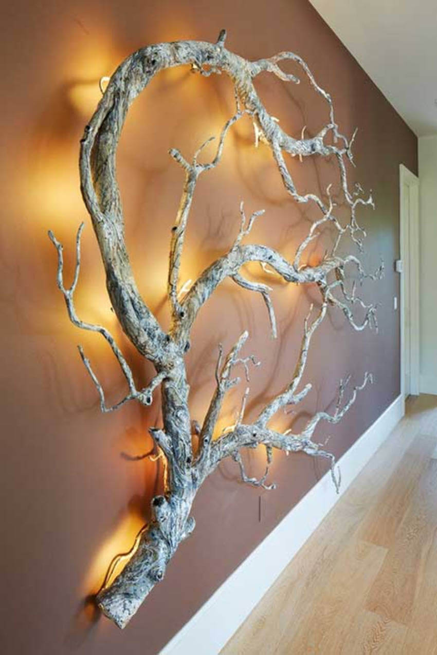 A wooden tree art is perfect to bring in the warmth and a touch of nature!