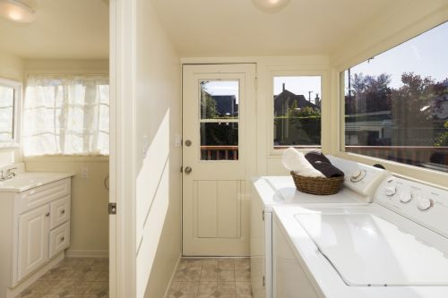 Clean colors are accentuated by the sun in this laundry room