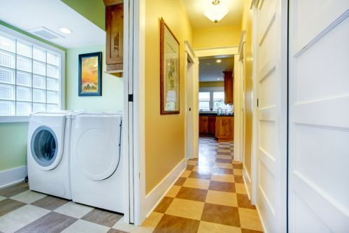 Beautifully segmented laundry room on way to kitchen