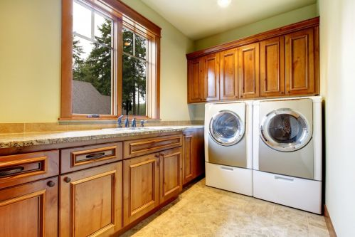 Gorgeous cabinets in this spacious laundry room
