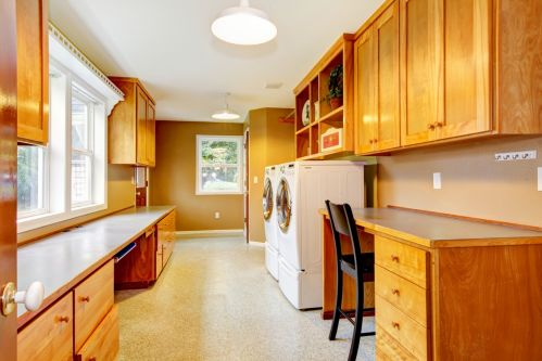 Well-lit and spacious laundry room with room to work