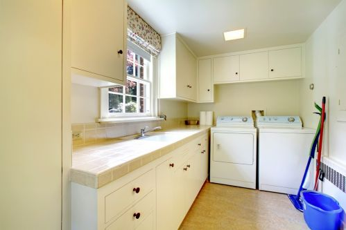 Laundry room with storage space and view of backyard