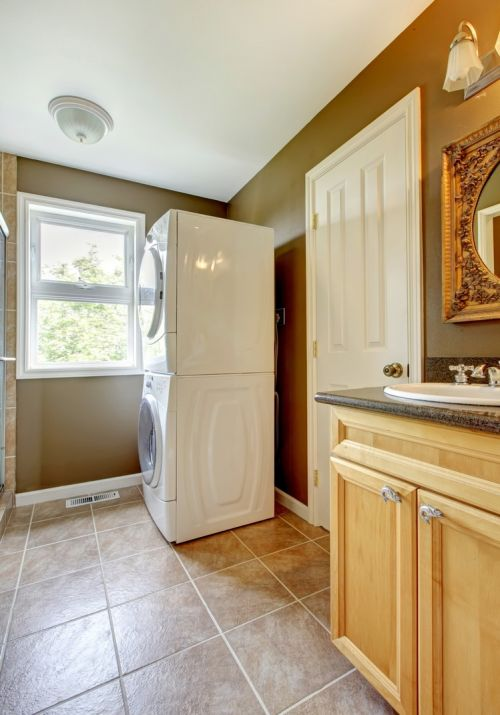 Beautiful tile work and colors in laundry room