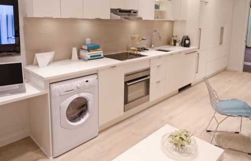 Gorgeous kitchen with washer dryer built in