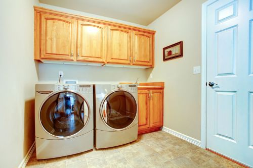 Small laundry rooms work best with light colors