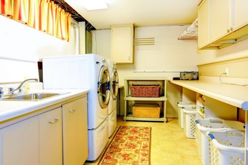 Warm colors create an inviting and productive laundry room