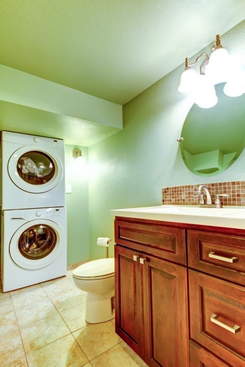 Lovely green paint in this laundry room and half bathroom