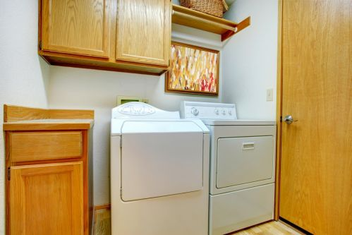 Classic laundry room with wood cabinets