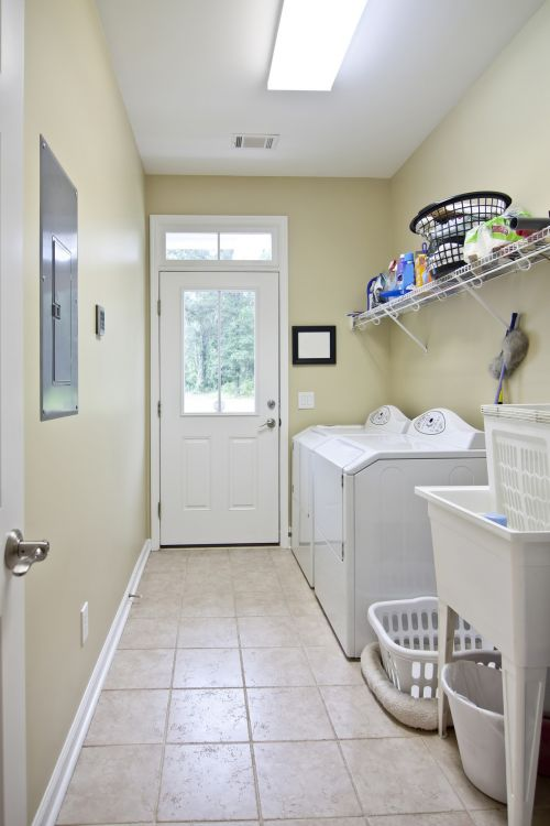 Beautifully simple laundry room on way to back yard