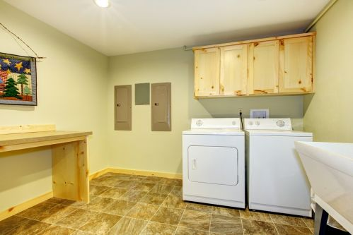 Eye-catching cabinets and counter top in this unique laundry room